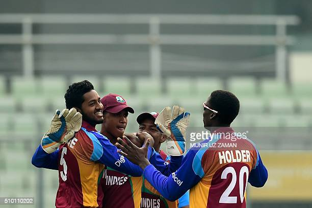 West Indies cricketers celebrate after the dismissal of the Indian cricketer Rishabh Pant during the Under19 World Cup cricket final between India...