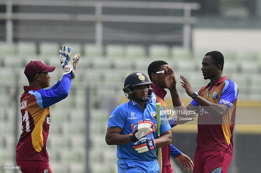 West Indies cricketers celebrate after the dismissal of the Indian cricketer Sarfaraz Khan (2nd L) during the under-19s World Cup cricket final between India and West Indies at the Sher-e-Bangla National Cricket Stadium in Dhaka on February 14, 2016. AFP PHOTO/Munir uz ZAMAN / AFP / MUNIR UZ ZAMAN