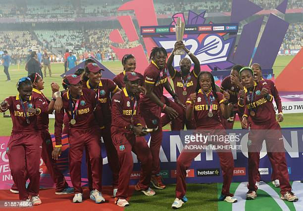 West Indies cricketers celebrate after winning the women's World T20 cricket tournament final match between Australia and West Indies at The Eden...
