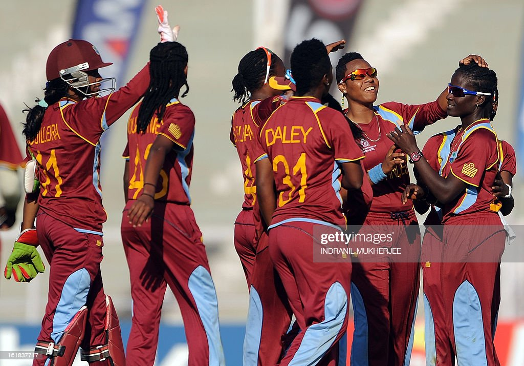 West Indies cricketers celebrate the wicket of unseen Australian cricketer Jess Cameron during the final match of the ICC Women's World Cup 2013 between Australia and West Indies at the Cricket Club of India's Brabourne stadium in Mumbai on February 17, 2013. AFP PHOTO/Indranil MUKHERJEE