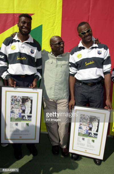 West Indies' cricketers past and present Curtley Ambrose Viv Richards and Courtney Walsh at Ferndale Sports Centre in Brixton London with two...