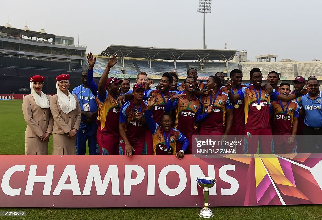 West Indies cricketers pose with the trophy after winning the Under-19 World Cup cricket final between India and West Indies at the The Sher-e-Bangla National Cricket Stadium in Dhaka on February 14, 2016. AFP PHOTO / Munir uz ZAMAN / AFP / MUNIR UZ ZAMAN