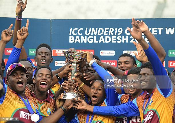 West Indies cricketers pose with the trophy after winning the Under19 World Cup cricket final between India and West Indies at the The ShereBangla...