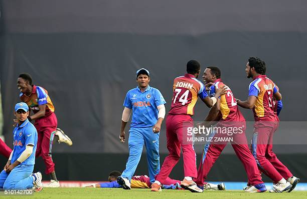 West Indies cricketers react after winning the Under19 World Cup cricket final between India and West Indies at the The ShereBangla National Cricket...