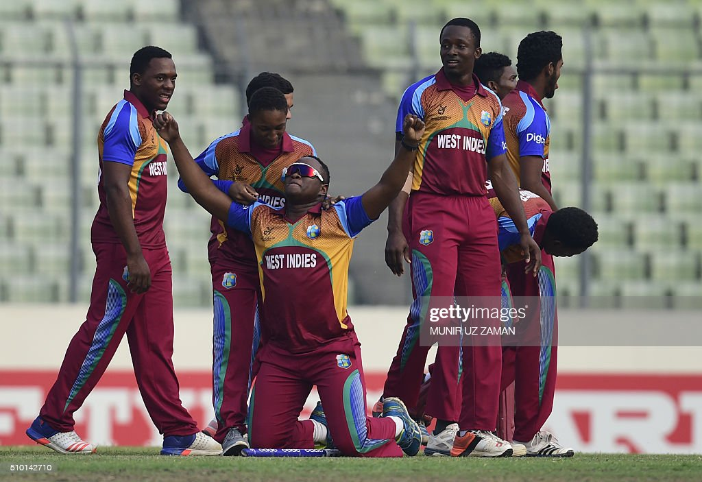 West Indies cricketers react after winning the Under-19 World Cup cricket final between India and West Indies at the The Sher-e-Bangla National Cricket Stadium in Dhaka on February 14, 2016. AFP PHOTO / Munir uz ZAMAN / AFP / MUNIR UZ ZAMAN