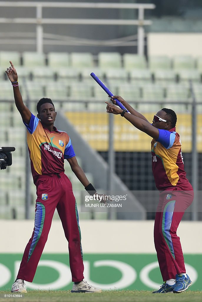 West Indies cricketers Shamar Springer (L) and Gidron Pope react after winning the Under-19 World Cup cricket final between India and West Indies at the The Sher-e-Bangla National Cricket Stadium in Dhaka on February 14, 2016. AFP PHOTO / Munir uz ZAMAN / AFP / MUNIR UZ ZAMAN