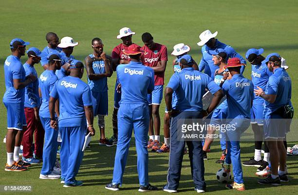 West Indies' crickets gather for a team chat before the start of a training session on October 20 at the Sheikh Zayed Cricket stadium in Abu Dhabi in...