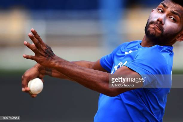 TOPSHOT West Indies' Devendra Bishoo delivers a ball during a practice session at the Queen's Park Oval in Port of Spain Trinidad on June 22 ahead of...