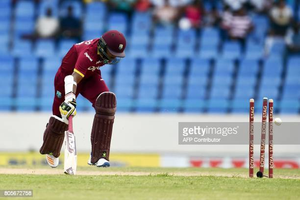 West Indies' Devendra Bishoo gets runout during the fourth One Day International match between West Indies and India at the Sir Vivian Richards...