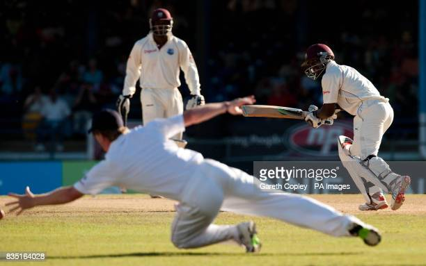 West Indies' Devon Smith hits the ball past England's Paul Collingwood during the fifth test at Queen's Park Oval Port of Spain Trinidad
