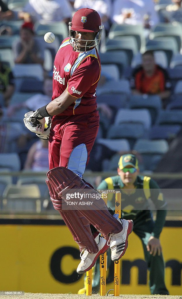 West Indies Dwayne Bravo avoids a high ball during the one-day international cricket match between Australia and the West Indies at the WACA ground in Perth on February 3, 2013. AFP PHOTO/Tony ASHBY IMAGE