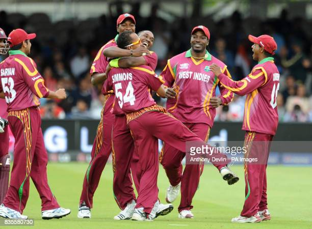 West Indies' Dwayne Bravo celebrates taking the wicket of India's Gautam Gambhir with the catcher Lendl Simmons during the ICC World Twenty20 Super...