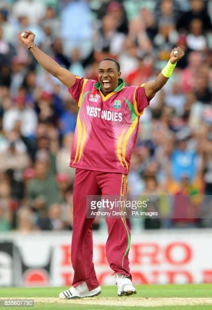 West Indies' Dwayne Bravo celebrates taking the wicket of Sri Lanka's captain Kumar Sangakkara during the ICC World Twenty20 Semi Final at The Oval...