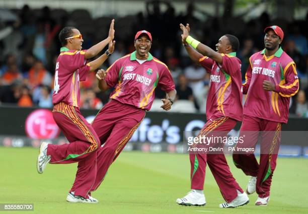 West Indie's Dwayne Bravo celebrates taking thwe wicket of india's Gautam Gambhir with catcher teammate Lendl Simmons during the ICC World Twenty20...