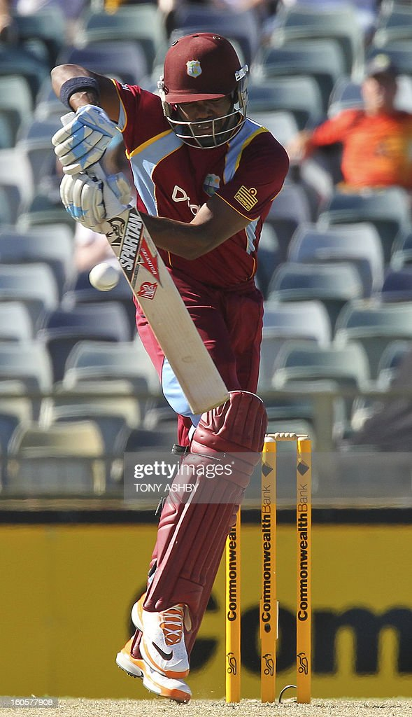 West Indies Dwayne Bravo defends a high ball during the one-day international cricket match between Australia and the West Indies at the WACA ground in Perth on February 3, 2013. AFP PHOTO/Tony ASHBY USE