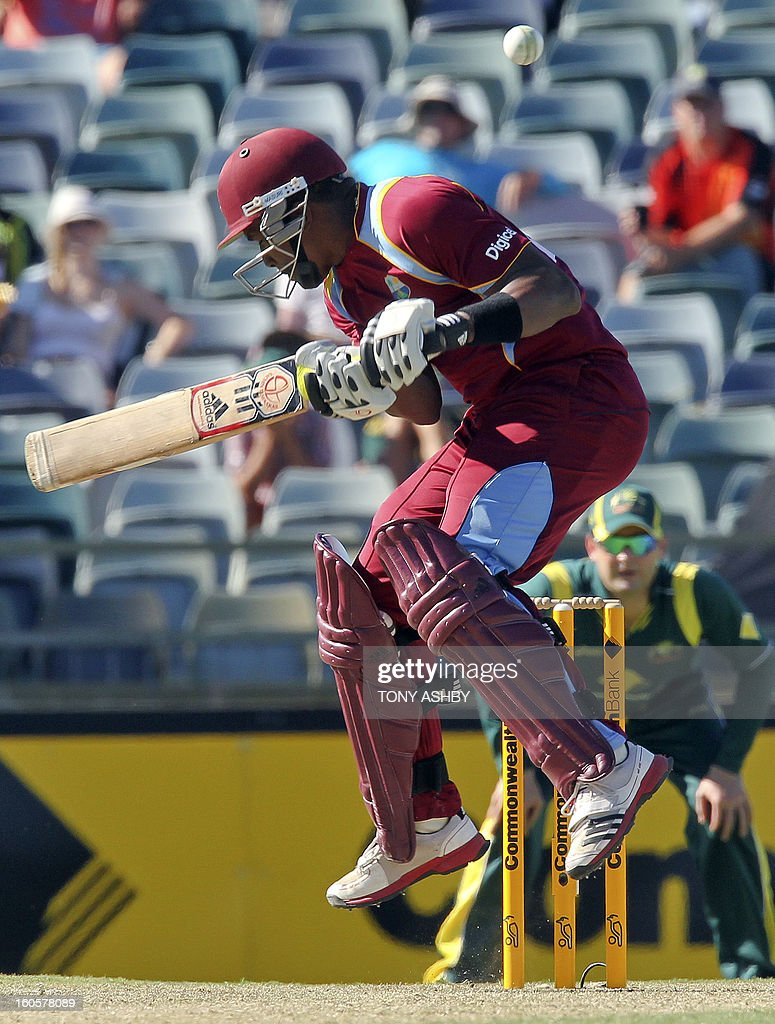 West Indies Dwayne Bravo ducks a bouncer during the one-day international cricket match between Australia and the West Indies at the WACA ground in Perth on February 3, 2013. AFP PHOTO/Tony ASHBY USE