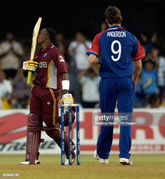 West Indies' Dwayne Bravo kisses his bat as he celebrates his century during the ICC Champions Trophy match at the Sardar Patel Stadium Ahmedabad...