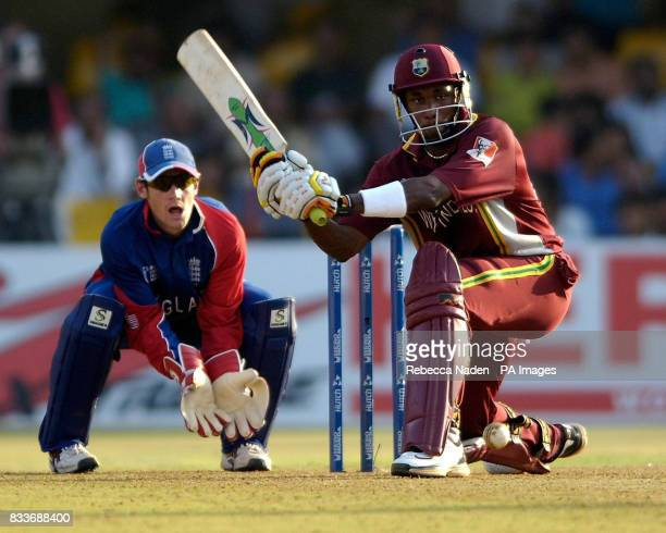 West Indies' Dwayne Bravo sweeps the ball during the ICC Champions Trophy match against England at the Sardar Patel Stadium Ahmedabad India