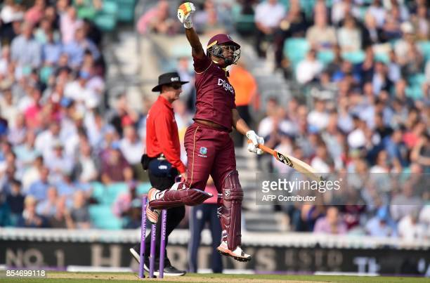 West Indies' Evin Lewis celebrates his century during the fourth OneDay International cricket match between England and the West Indies at the Oval...
