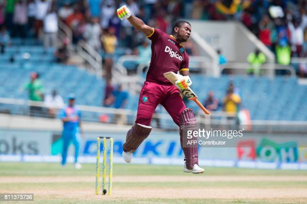 West Indies' Evin Lewis celebrates scoring a century during the T20 match between West Indies and India at the Sabina Park Cricket Ground in Kingston...