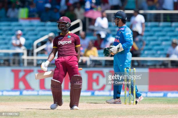 West Indies' Evin Lewis dances as he celebrates winning the T20 match between West Indies and India at the Sabina Park Cricket Ground in Kingston...