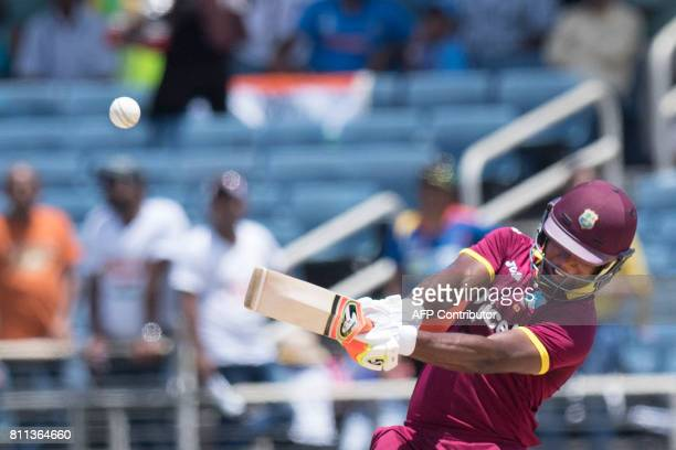West Indies' Evin Lewis plays a shot during the T20 match between West Indies and India at the Sabina Park Cricket Ground in Kingston Jamaica on July...