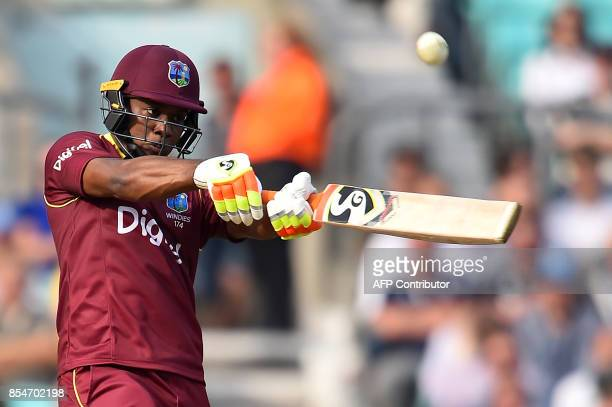 West Indies' Evin Lewis plays a shot for six runs during the fourth OneDay International cricket match between England and the West Indies at the...