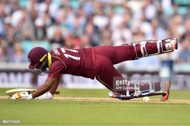 West Indies' Evin Lewis reacts after being hit by the ball during the fourth OneDay International cricket match between England and the West Indies...