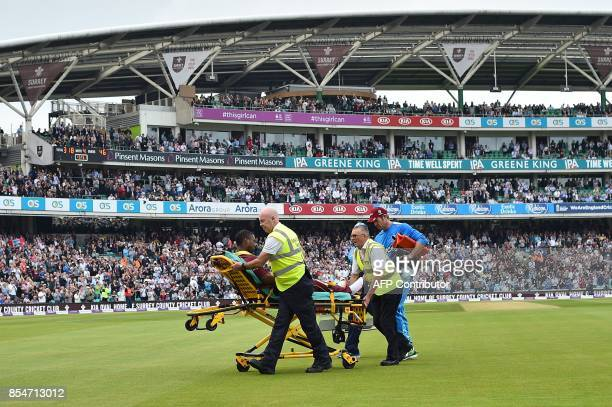 West Indies' Evin Lewis sits on a stretcher as he is taken off of the pitch after being hit by the ball during the fourth OneDay International...