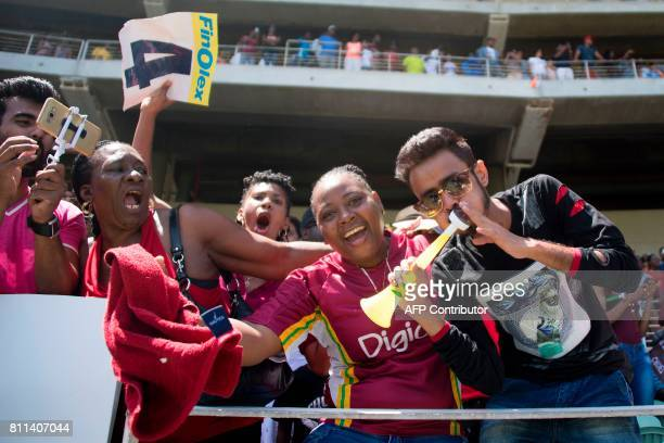 West Indies' fans celebrate their victory during the T20 match between West Indies and India at the Sabina Park Cricket Ground in Kingston Jamaica on...