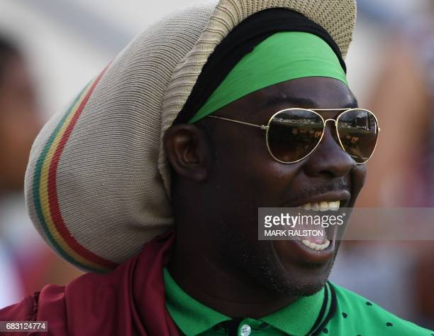 West Indies fans enjoy the cricket against Pakistan on the fifth days play of the final test match at the Windsor Park Stadium in Roseau Dominica on...