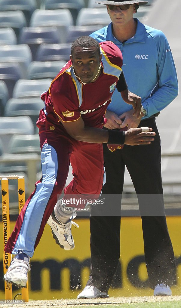 West Indies fast bowler D. J. Bravo in action during the one-day international cricket match between Australia and the West Indies at the WACA ground in Perth on February 3, 2013. AFP PHOTO/Tony ASHBY IMAGE