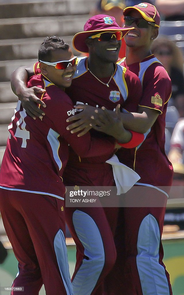 West Indies fast bowler Darren Sammy (C) is congratulated by teammates after taking a superb catch to remove Australia's batsman Matthew Wade during the one-day international cricket match between Australia and the West Indies at the WACA ground in Perth on February 3, 2013. AFP PHOTO/Tony ASHBY USE