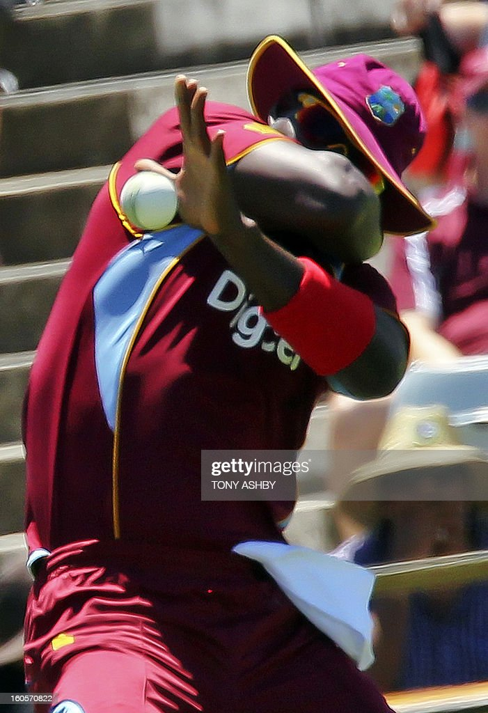 West Indies fast bowler Darren Sammy reacts after taking a catch to remove Australia's batsman Matthew Wade during the one-day international cricket match between Australia and the West Indies at the WACA ground in Perth on February 3, 2013. AFP PHOTO/Tony ASHBY IMAGE