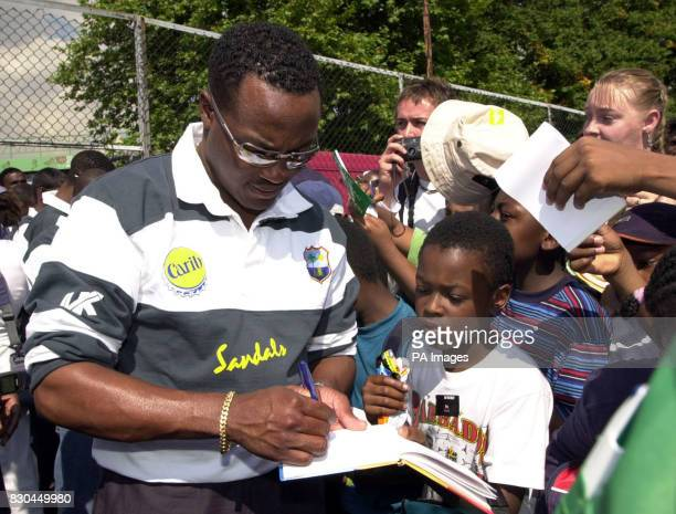 West Indies' former cricket captain Brian Lara signs autographs for local children at Ferndale Sports Centre in Brixton London at a youth cricket...
