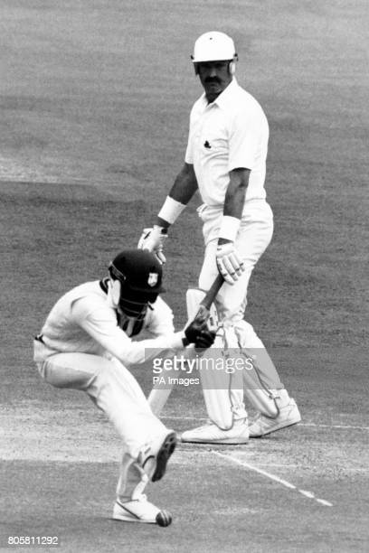 West Indies Gus Logie misses a catch at silly point watched by a relieved england batsman Graham Gooch