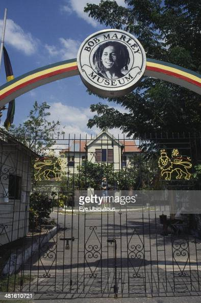 West Indies Jamaica Kingston Bob Marley Museum entrance with metal gate under archway