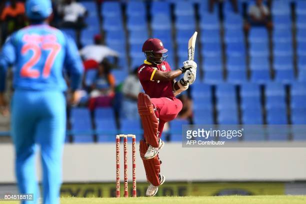 West Indies' Jason Mohammed plays a shot during the third One Day International match between West Indies and India at the Sir Vivian Richards...