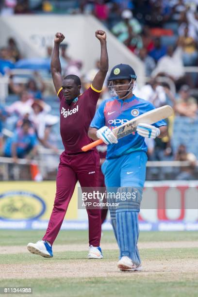 West Indies' Jerome Taylor celebrates after catching out India's MS Dhoni during the T20 match between West Indies and India at the Sabina Park...