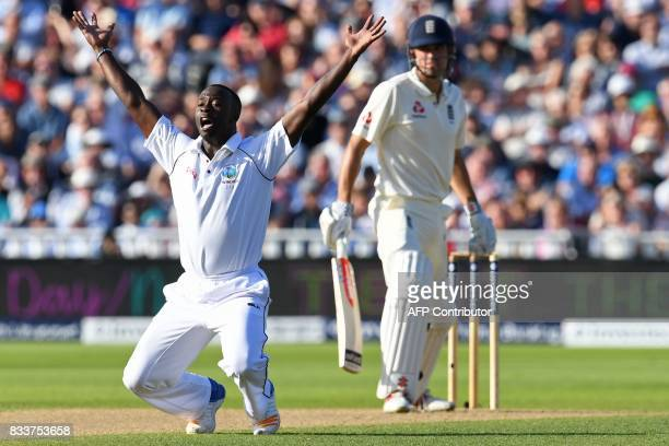 West Indies' Kemar Roach appeals unsuccessfully for the wicket of England's Alastair Cook during play on the opening day of the first Test cricket...