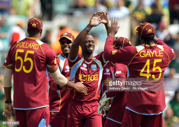 West Indies' Kemar Roach celebrates bowling out Pakistan's Mohammad Hafeez during the ICC Champions Trophy match at The Oval London