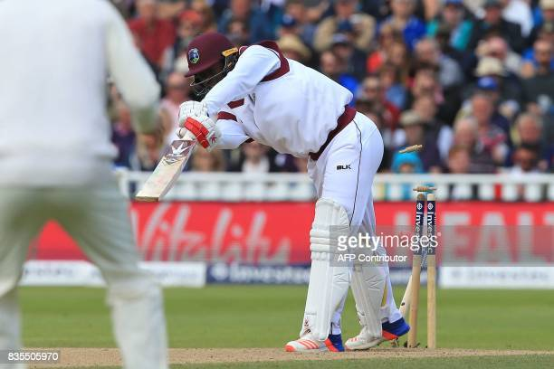 West Indies' Kemar Roach is bowled by England's Stuart Broad during play on day 3 of the first Test cricket match between England and the West Indies...
