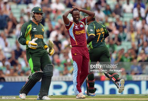 West Indies' Kemar Roach reacts as Pakistan's MisbahulHaq and Nasir Jamshed put runs on the board during the ICC Champions Trophy match at The Oval...