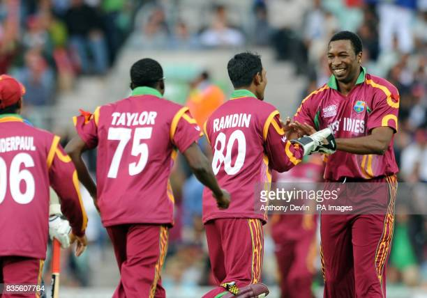 West Indies' Kieron Pollard is congratulated after taking the wicket of Mahela Jayawardane during the ICC World Twenty20 Semi Final at The Oval London