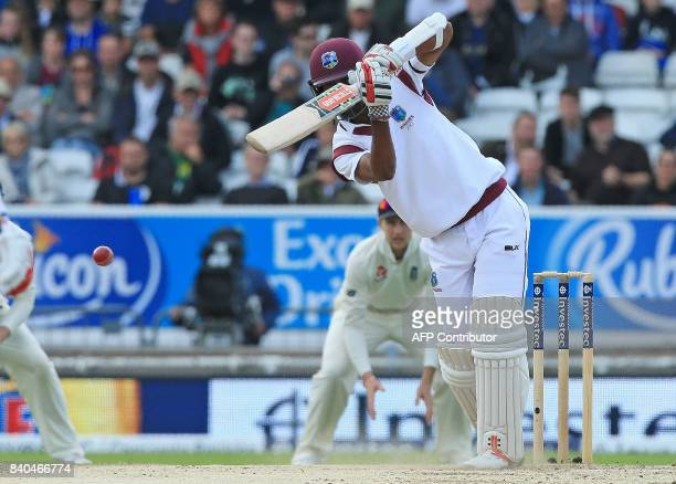 West Indies' Kraigg Brathwaite plays a shot only for teammate West Indies' Kyle Hope to be runout by England's Stuart Broad on the fifth day of the...