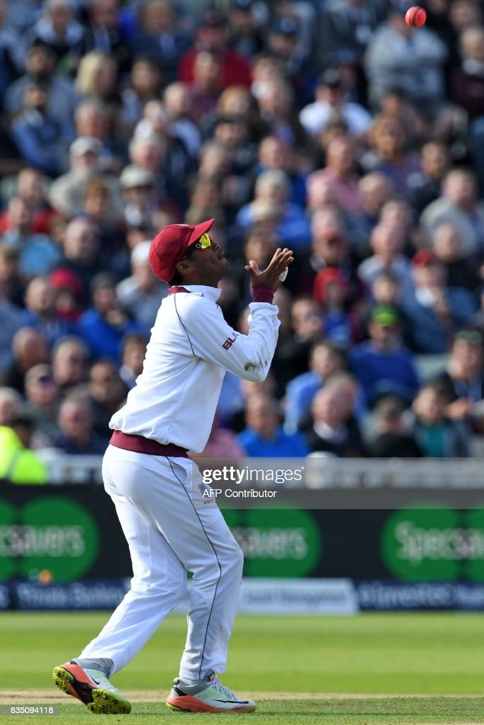 West Indies' Kraigg Brathwaite takes a catch to dismiss England's Moeen Ali during play on day 2 of the first Test cricket match between England and the West Indies at Edgbaston in Birmingham, central England on August 18, 2017. / AFP PHOTO / Paul ELLIS / RESTRICTED