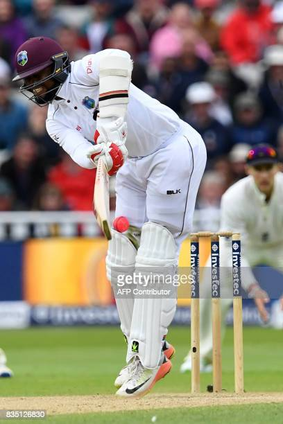 West Indies' Kyle Hope is struck by a short ball during play on day 2 of the first Test cricket match between England and the West Indies at...