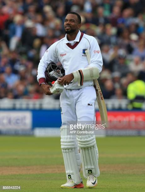 West Indies' Kyle Hope walks back to the pavilion after losing his wicket during play on day 3 of the first Test cricket match between England and...