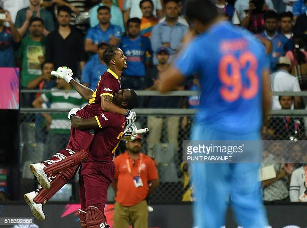West Indies Lendl Simmonscelebrates after winning the World T20 cricket tournament semifinal match against India at The Wankhede Cricket Stadium in...
