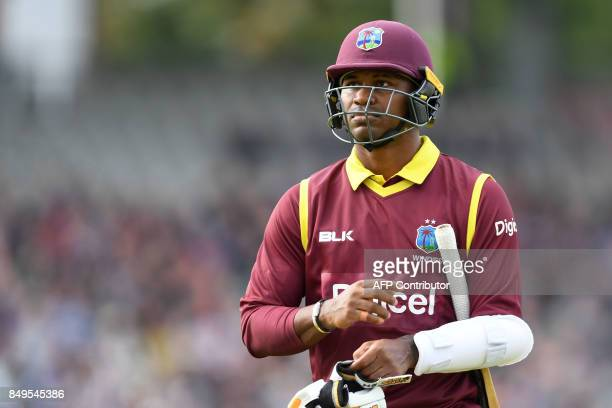West Indies' Marlon Samuels leaves the pitch after losing his wicket for 17 during the first OneDay International cricket match between England and...